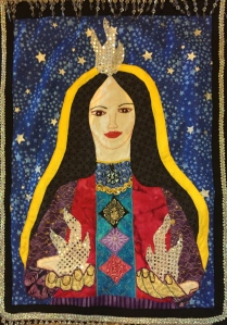 This is an applique I created that gives you a sense of Aruhatala--her beauty, love, and the White Christed Light coming through her and out her hands.